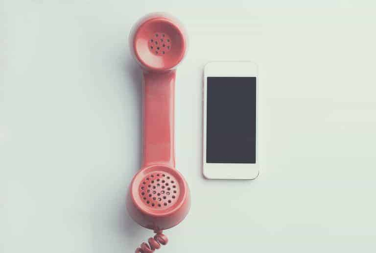 Canva Flat Lay Photography of Red Anti radiation Handset Telephone Beside Iphone